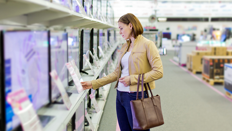 Woman shopping for televisions